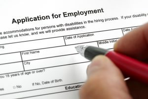 applicant-filling-out-employment-agency-application-form