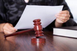 Female Judge Reading Verdict