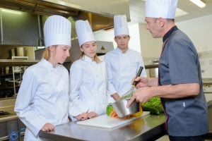 Cooking lesson with three apprentices