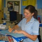 Nurse_Andrea_writing_up_her_notes3