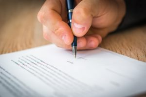 Person is signing a job contract
