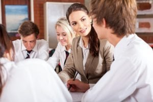 Teacher talking to pupil