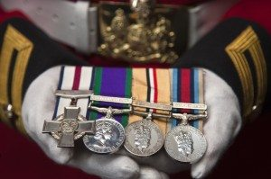 A Soldier Proudly Holds His Medals