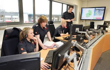 Fire Service 999 Call handlers discussing an operational incident
