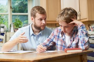 Parent helping son with homework