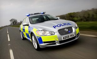 police constables drive police cars
