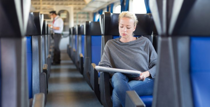 How-to-become-a-train-conductor-checking-tickets-in-carriage