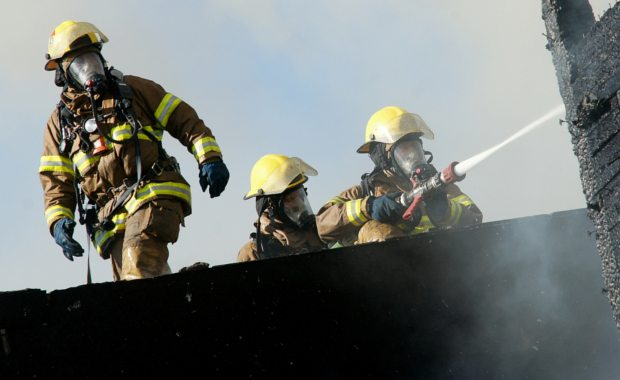 how-to-become-a-fire-fighter-firemen-putting-out-a-fire
